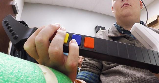 Study: Brain implant lets paralyzed man regain use of hand