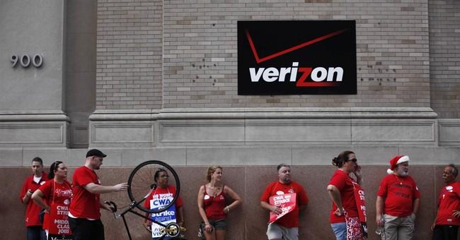The Latest: Bernie Sanders joins Verizon picket line in NYC