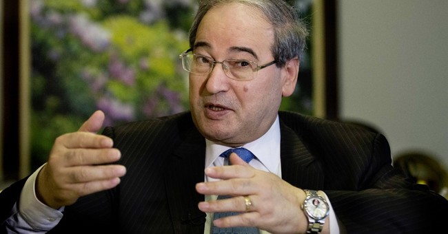 AP INTERVIEW: Top Syrian official rules out Assad departure