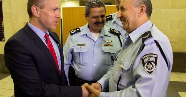 Amid violence, Israel promotes Arab police officer