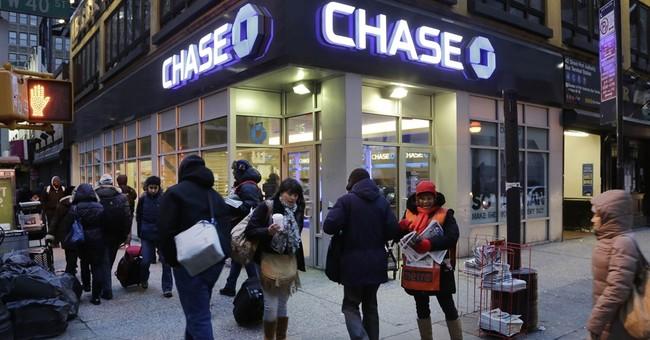 JPMorgan profit falls 8 percent, fails key regulatory test