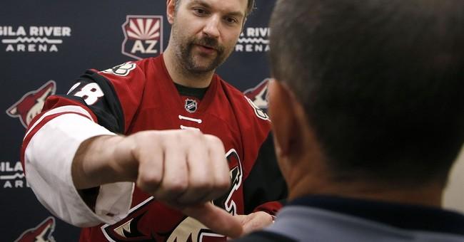 Fighting the bear: John Scott demonstrates a hockey fight
