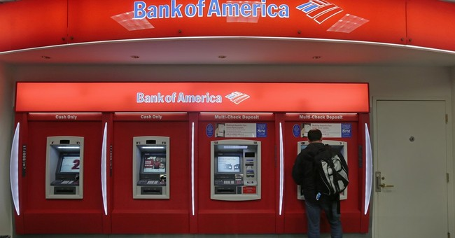 Low rates, troubled loans send bank profits lower
