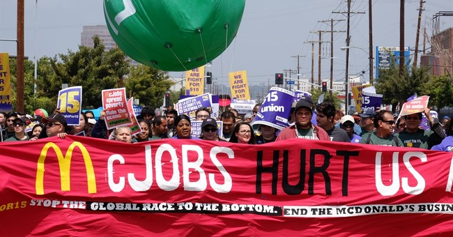McDonald's stores targeted by protests for $15/hour, union