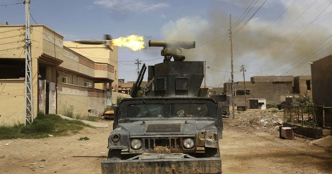 Iraqi forces rely on air power in battling IS for key town