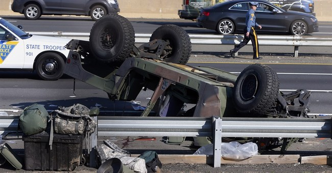 Military vehicle overturns in New Jersey, hurting 4 soldiers