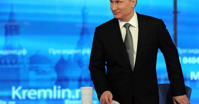 The Latest: Putin backs armed monitors for eastern Ukraine
