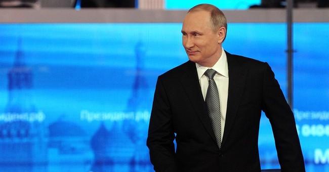 The Latest: Putin backs armed monitors for eastern Ukraine