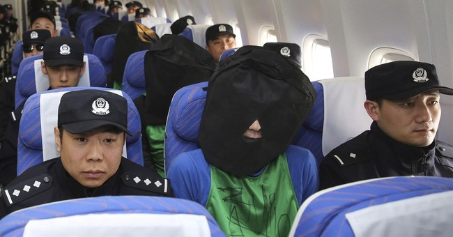 China criticizes Taiwan for releasing fraud suspects
