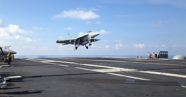 US defense chief visits aircraft carrier in South China Sea