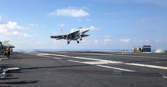 US defense chief visits aircraft carrier in South China Sea