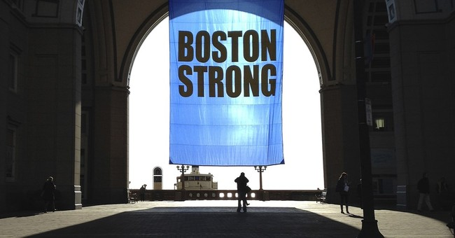 The Latest: Moment of silence observed for marathon bombing
