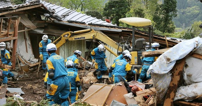 Searchers find body in twin Japan quakes, raising toll to 45