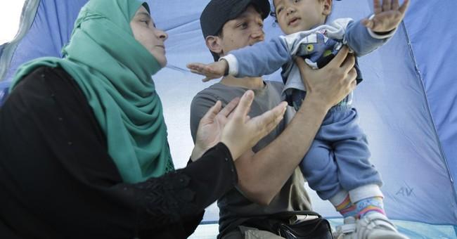 The Latest: France's Le Pen criticizes EU refugee approach