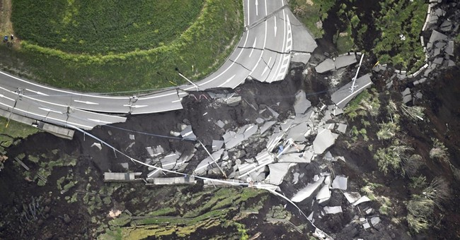 Twin quakes kills at least 29 in south Japan; many trapped