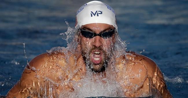 Ledecky and Phelps swim to victories in Arizona