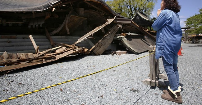 Japanese seek 'holy water' at quake-damaged Shinto shrine