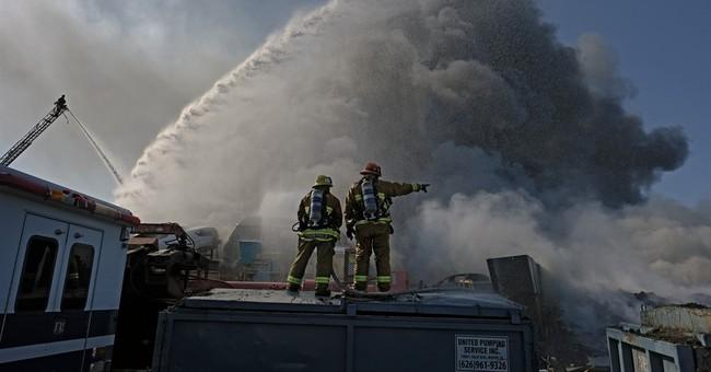 Fire at LA junkyard sends huge black plume over city
