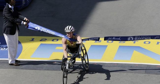 The Latest: Bomb survivor runs marathon on prosthetic blade