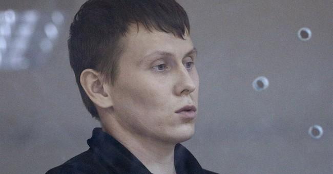 2 Russian servicemen in Ukraine sentenced to 14 years