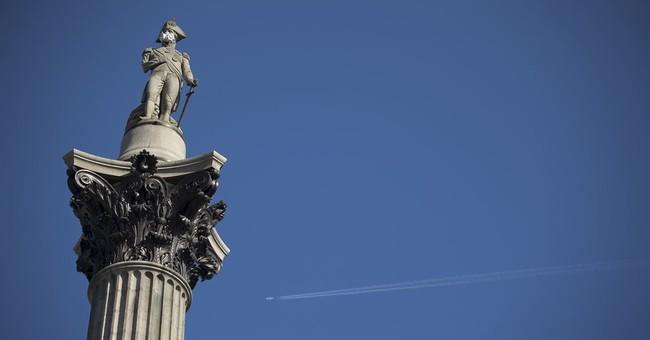 Greenpeace demonstrators affix gas mask to Nelson's Column