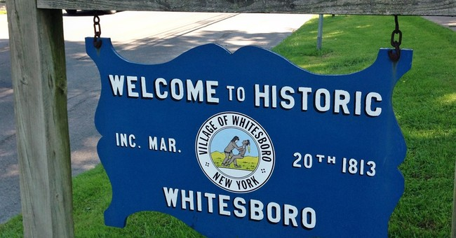 Central NY village votes to keep logo criticized as racist