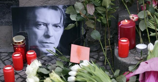 AP PHOTOS: Fans gather to remember David Bowie