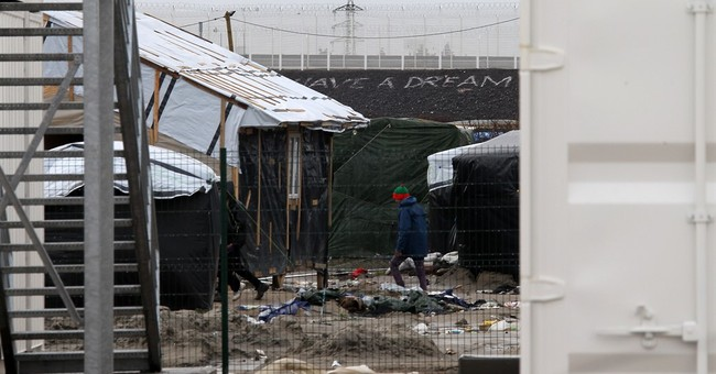 Migrants in squalid camps in France get housing upgrade