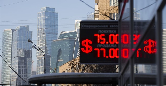 Russia's ruble slumps on first day of trading after holiday