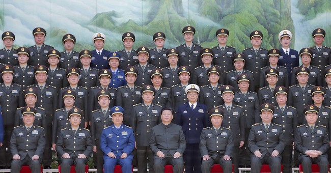 China's Xi reorganizes military headquarters structure
