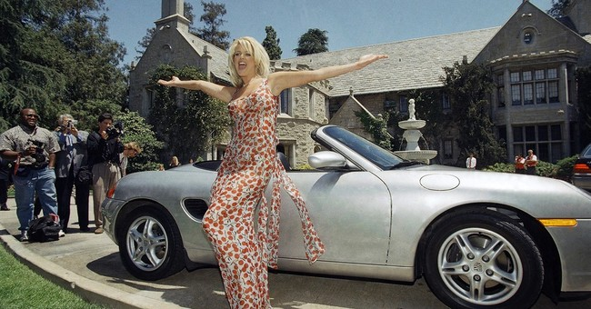 Playboy Mansion for sale but Hugh Hefner wants to stay put