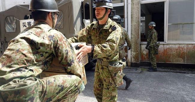 Cold rice balls, no flush toilets at quake-hit Japan shelter
