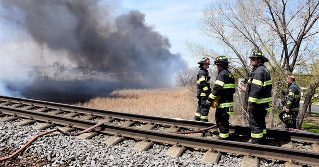 Brush fires near tracks halt trains near New York City