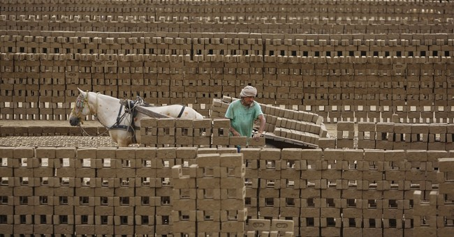 Image of Asia: Making bricks in India