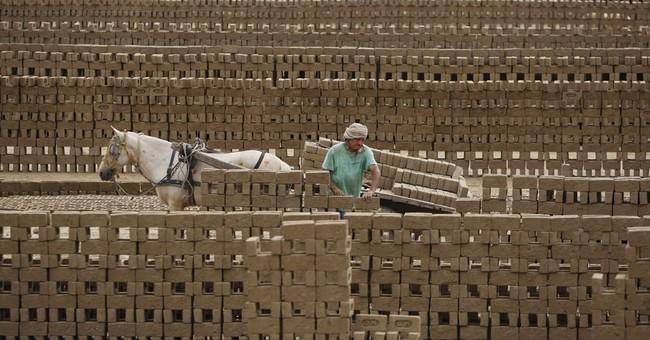 Image of Asia: Making bricks in India