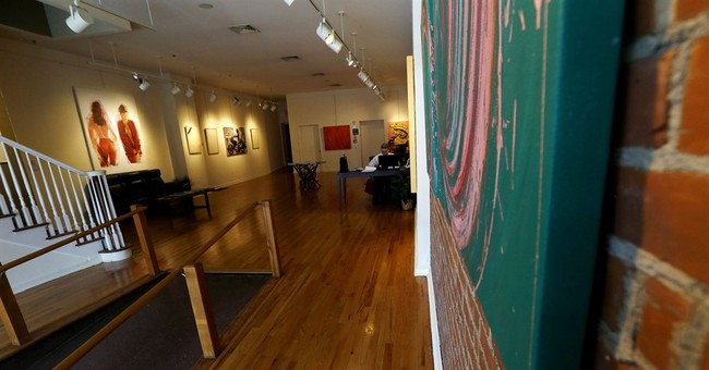 Gallery sues over fines for artwork of partially nude woman