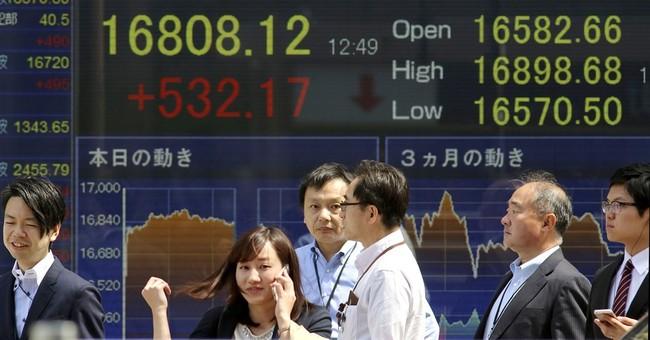 Asian stocks mostly higher, Japan rallies as yen weakens