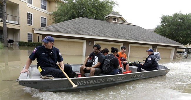 The Latest: Houston-area flooding death toll now at 6