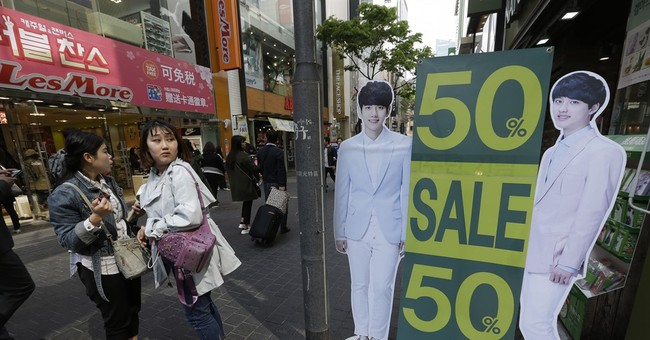 South Korea's central bank cuts growth forecast