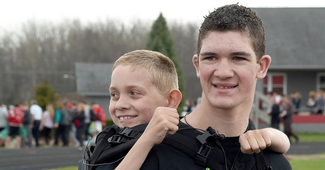 Michigan teen begins 111-mile walk with brother on back