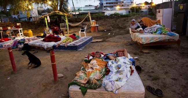 Ecuador hikes taxes as deadly quake compounds economic pain