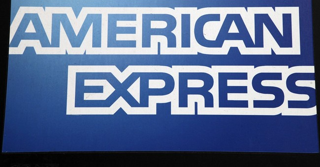 American Express' earnings fall, but still beat estimates