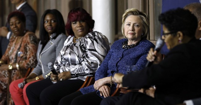The Latest: Black protesters disrupt Clinton rally in Pa.