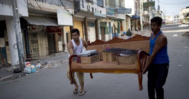 The Latest: Ecuador to raise taxes to fund quake recovery