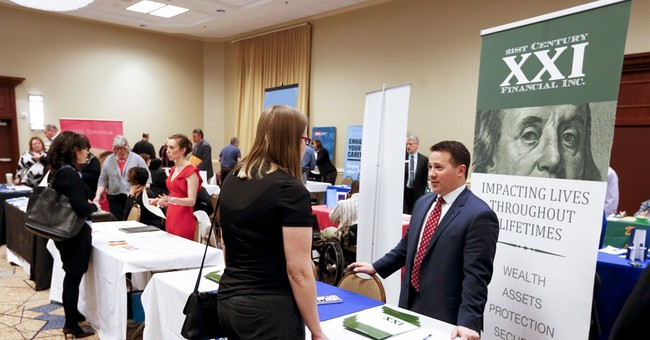 US applications for jobless aid fall to four-decade low