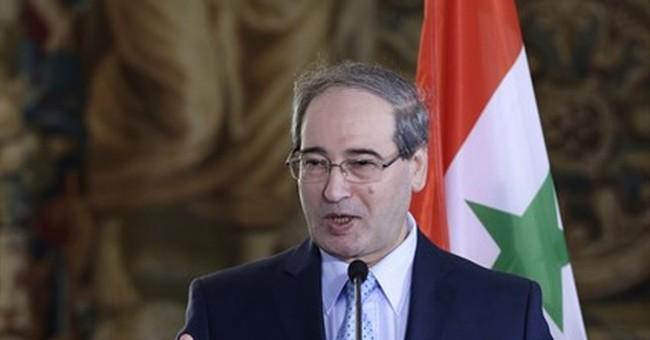 Aid reaches besieged Syria town amid concerns for truce