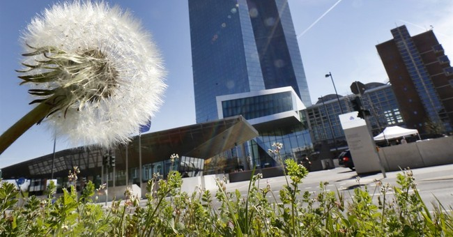 The Latest: ECB chief downplays idea of 'helicopter money'