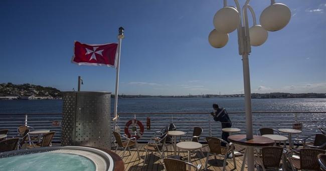 Cuba relents, allows Cuban-born travelers on historic cruise