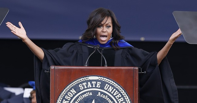 Michelle Obama urges grads to vote to protect civil rights