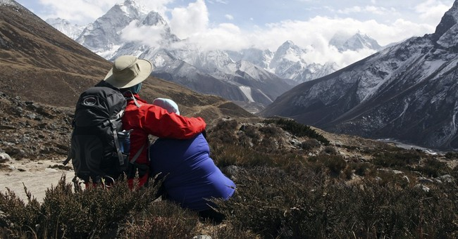Despite back-to-back disasters, climbers return to Everest